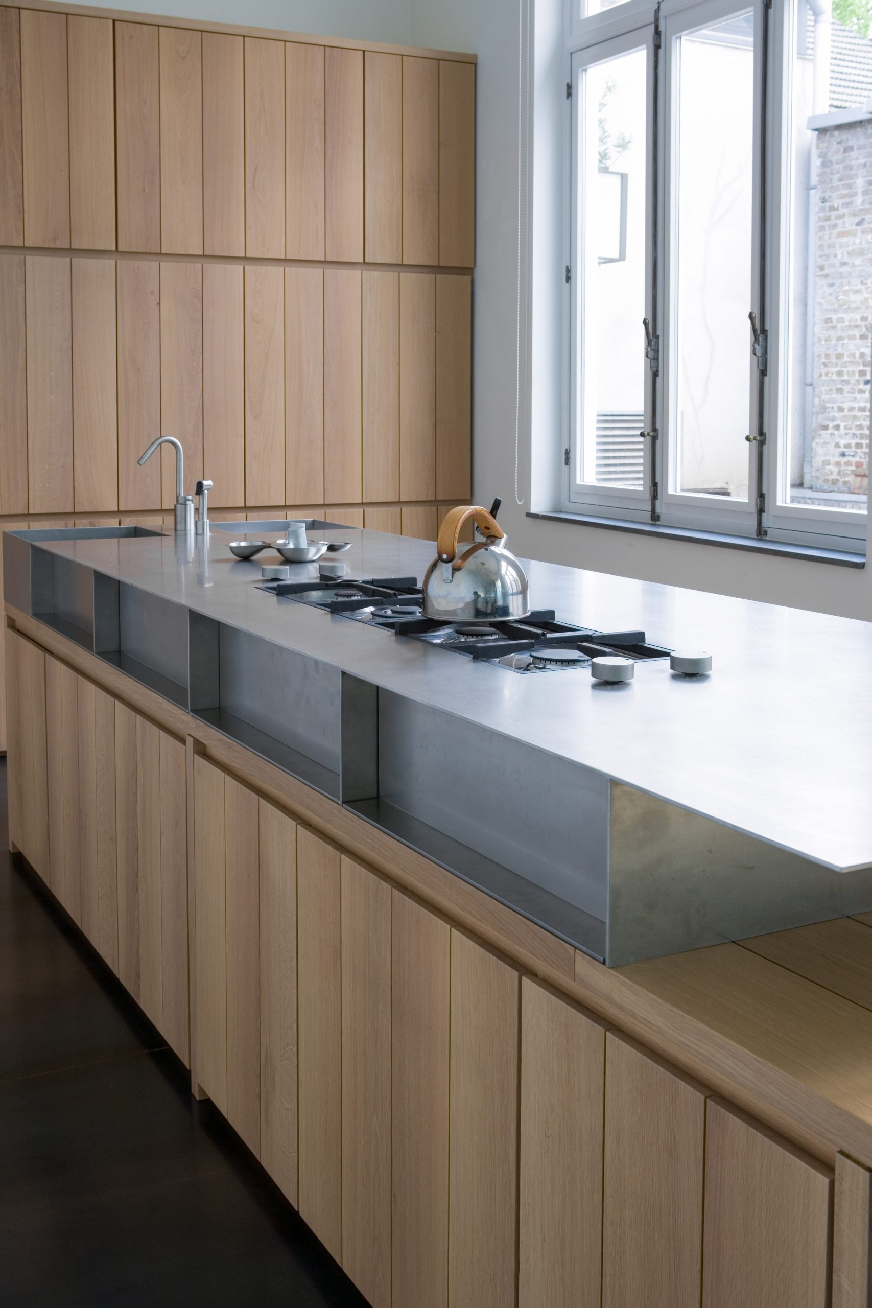 Stainless steel table top in wooden kitchen
