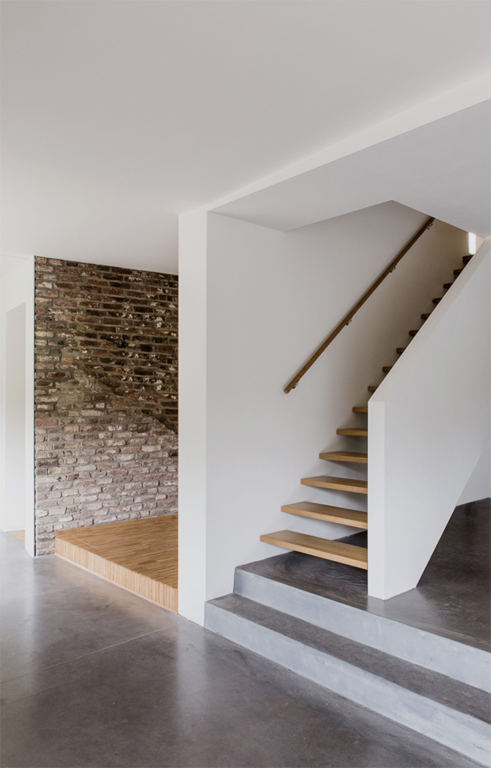 Stair case design with rustic brick wall