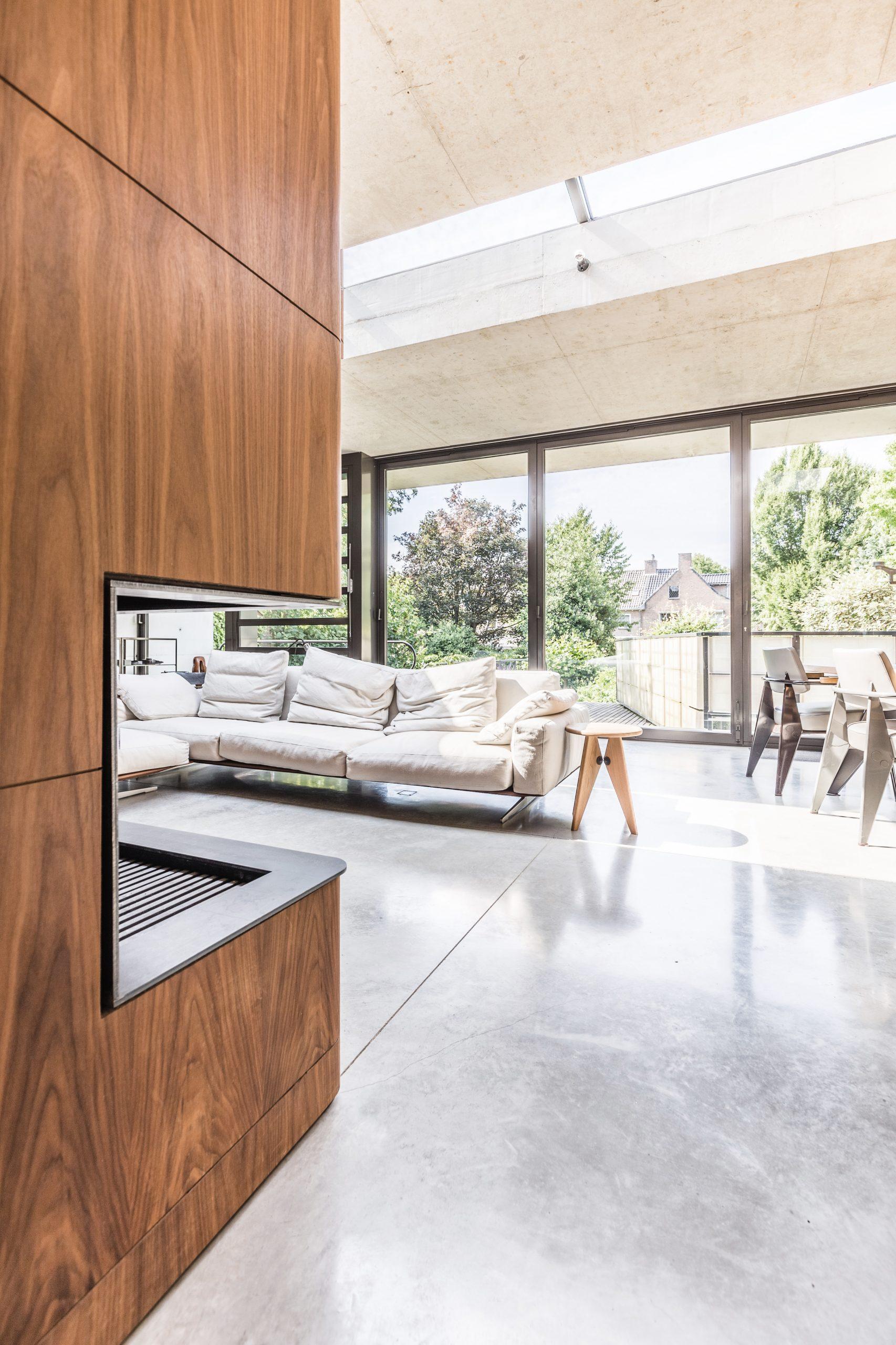 Open Garden open living room design with fireplace